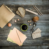 Breakfast business person. Coffee, sheets of notes and stationery on wooden table. top view stock photos