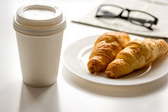 Breakfast for businessman with coffee and croissant on white table Stock Image