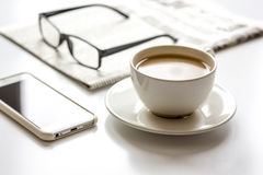 Breakfast for businessman with coffee and mobile on white table Royalty Free Stock Photos