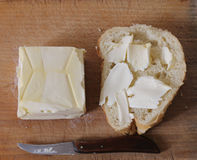 Breakfast. Butter and a piece of bread for breakfast Royalty Free Stock Photo