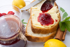 Breakfast with butter and strawberry jam. Royalty Free Stock Image