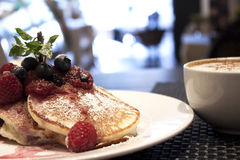 Breakfast of buttermilk pancakes with fresh berries and coffee Royalty Free Stock Photo