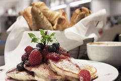 Breakfast of buttermilk pancakes with fresh berries Royalty Free Stock Images