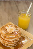 Breakfast Buttermilk Pancakes With Syrup and Fresh Orange Juice Royalty Free Stock Photo