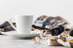 Breakfast in cafe with coffee cup and scarf on table Stock Image