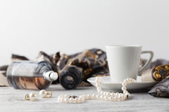 Breakfast in cafe with coffee cup and scarf on table Stock Images