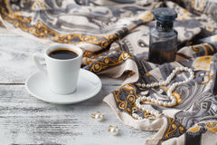 Breakfast in cafe with coffee cup and scarf on table Royalty Free Stock Photo