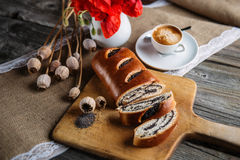 Breakfast cake with cup of cup of coffee on breadboard, flowers, red poppy, sweet baked desert, espresso Stock Photo
