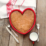 Breakfast cake inside heart baking tin over wood with vintage si Royalty Free Stock Photos