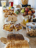Breakfast cakes and fruits Stock Photos