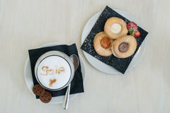 Breakfast with cappuccino and biscuit Royalty Free Stock Images