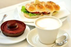 Breakfast  with cappuccino and chocolate cake Stock Photos