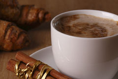 Breakfast with coffee. Breakfast with cappuccino, cinnamon and croissant Stock Images