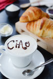 Breakfast cappuccino design - ciao. Cappuccino decorato e croissant breakfast Royalty Free Stock Image