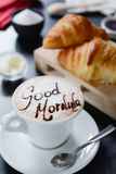 Breakfast cappuccino design - Good morning. Cappuccino decorato e croissant breakfast Royalty Free Stock Photos