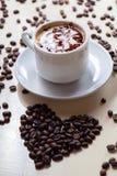 Breakfast Cappucino with love symbol raw coffee. Picture of Breakfast Cappucino with love symbol raw coffee Stock Photography