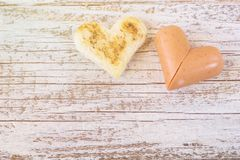 Breakfast for the celebration of Valentine day with sausage and eggs in the bread heart shaped.  royalty free stock image