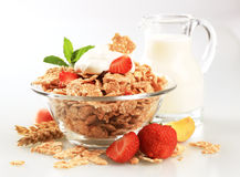 Breakfast cereal. Topped with white yogurt, served with fresh strawberries Stock Photos