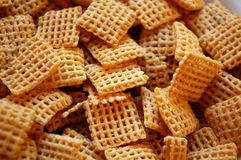 Breakfast Cereal. Crispy chex style breakfast cereal squares Royalty Free Stock Photos