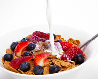Breakfast cereal. Fresh fruits, cereal and milk royalty free stock photo