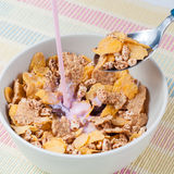 Breakfast cereal. With cornflakes and fruit yogurt Royalty Free Stock Image