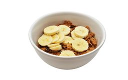 Breakfast Cereal with Banana. An isolated image of a bowl of breakfast cereal with banana slices Royalty Free Stock Photos