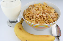 Breakfast Cereal and Banana. Still life of a breakfast meal, including flaked cereal, milk and a banana stock photo