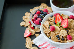 Breakfast - cereal and berries in white bowl Royalty Free Stock Photos