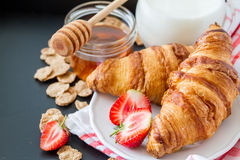 Breakfast - cereal and berries in white bowl, croissant Royalty Free Stock Photo