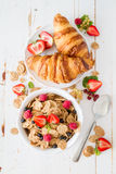 Breakfast - cereal and berries in white bowl Stock Photos