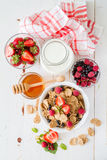 Breakfast - cereal and berries in white bowl Stock Photography