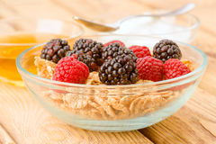 Breakfast cereal bowl with berries and yogurt Stock Photo