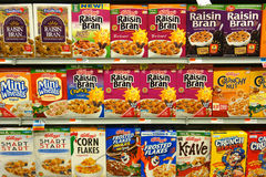 Breakfast Cereal Boxes. Different brands and kinds of breakfast cereal, for sale at a supermarket. Americans spend ten billion dollars a year in breakfast cereal Stock Photography