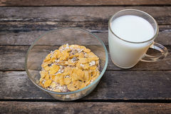Breakfast cereal and dry fruit  on wooden background Stock Images