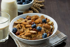 breakfast cereal flakes with blueberries and nuts stock photo