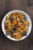 Breakfast cereal flakes with blueberries and nuts Royalty Free Stock Images