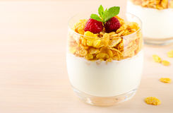 Breakfast with cereal flakes, yogurt and fresh raspberries Royalty Free Stock Photography
