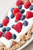 Breakfast cereal with fresh raspberries and yogurt Royalty Free Stock Photo