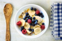 Breakfast cereal with fruit, spoon and cloth Royalty Free Stock Photo