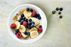 Breakfast cereal with fruit on white granite background Stock Photo