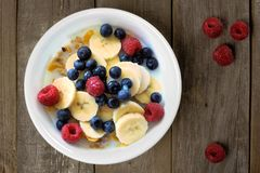 Breakfast cereal with fruit on a wood background Stock Photography