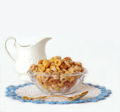 Breakfast Cereal in a Glass Bowl and a Vintage Cream Pitcher Iso Stock Photography