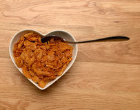 Breakfast cereal in heart shaped bowl Stock Photo