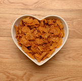 Breakfast cereal in heart shaped bowl Stock Image