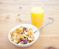 Breakfast cereal with juice. Breakfast cereal with a glass of orange juice Royalty Free Stock Photos