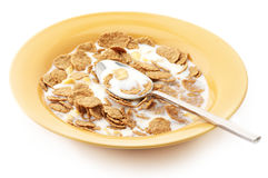 Breakfast cereal with milk. And spoon in orange plate on white background Royalty Free Stock Photography