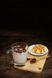 Breakfast cereal with milk and bread Waffle on a wood table - da Royalty Free Stock Images