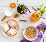 Breakfast of cereal, milk and donuts Stock Photos