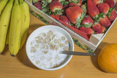Breakfast cereal with milk and fruit. On the table Stock Photography