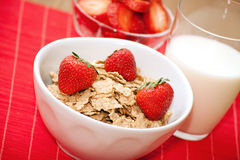 Breakfast cereal, milk and strawberries Royalty Free Stock Images
